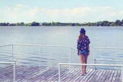 Woman sitting on a pontoon Royalty Free Stock Image