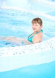 Woman sitting in a pool Royalty Free Stock Images