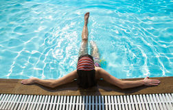 Woman sitting in pool stock photography
