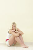 Woman in a sitting pose Royalty Free Stock Photos
