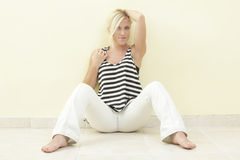 Woman in a sitting pose Royalty Free Stock Photo