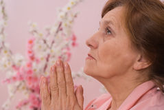 Woman sitting and praying Stock Photos