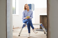 Woman Sitting In Property Being Renovated Royalty Free Stock Photos