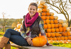 Woman sitting with pumpkin Royalty Free Stock Images