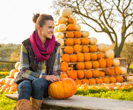 Woman sitting with pumpkin Royalty Free Stock Image