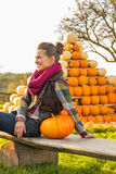 Woman sitting with pumpkin Royalty Free Stock Photo