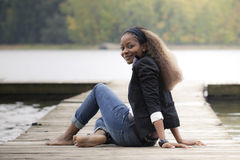 Woman sitting on quay Royalty Free Stock Photography