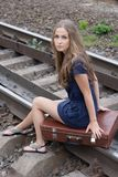 Woman sitting on rails Stock Images
