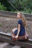 Woman sitting on rails Stock Photo