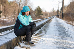 The woman sitting on rails of the railway Stock Photos