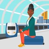 Woman sitting on railway platform. Royalty Free Stock Photo