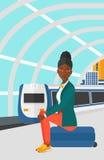 Woman sitting on railway platform. Stock Photography