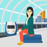 Woman sitting on railway platform. Stock Photo
