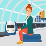 Woman sitting on railway platform. Stock Images