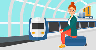 Woman sitting on railway platform. Stock Images