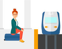 Woman sitting on railway platform Royalty Free Stock Photo