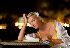 Woman sitting in a reastaurant Stock Image