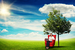 Woman sitting on the red chair Stock Images