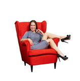 Woman sitting on red chair Royalty Free Stock Photo