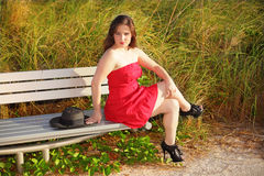 Woman sitting in a red dress Stock Photo