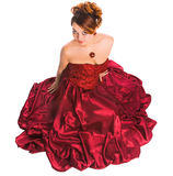 Woman sitting in red dress Royalty Free Stock Photos