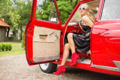 Woman sitting in red retro car Royalty Free Stock Photo