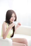 Woman sitting relaxed with hot coffee Royalty Free Stock Photo
