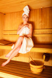 Woman sitting relaxed in wooden sauna Royalty Free Stock Photography