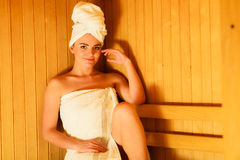 Woman sitting relaxed in wooden sauna Royalty Free Stock Photos
