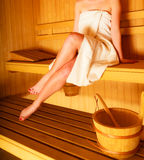 Woman sitting relaxed in wooden sauna Stock Image