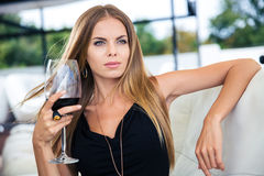 Woman sitting at the restaurant with glass of red wine Stock Photography