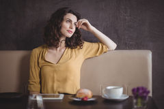 Woman sitting in restaurant Stock Photography