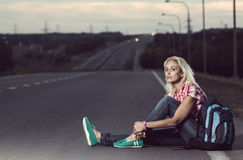 Woman sitting on the road Royalty Free Stock Photography