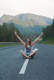 Woman sitting on the road Royalty Free Stock Image