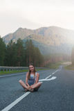 Woman sitting on the road Royalty Free Stock Photo