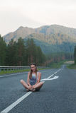 Woman sitting on the road Royalty Free Stock Photos