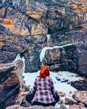 The woman sitting on the rock mountain. Young yoga woman sit meditation on mountain peak rock Stock Image