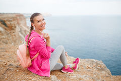 Woman sitting on rocky beach in the spring Royalty Free Stock Images