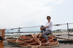 Woman sitting on rope Stock Photography