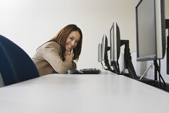 Woman Sitting At Row Of Computers Stock Image