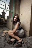 Woman sitting by a ruin Royalty Free Stock Images