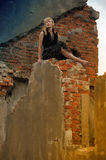 Woman  sitting on the ruins Stock Images