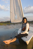Woman Sitting on Sailboat in Water - Vertical Royalty Free Stock Photos