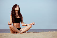 Woman sitting on sand Royalty Free Stock Photography