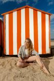 Woman beach sun sand hut, De Panne, Belgium stock image