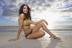 Woman sitting on the sand Royalty Free Stock Images