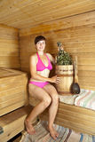 Woman  sitting  at sauna Royalty Free Stock Photo