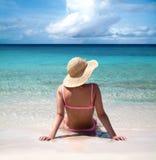 Woman sitting on seashore Royalty Free Stock Photo