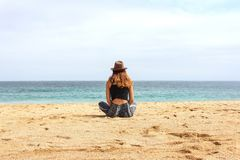 Woman Sitting on Seashore at Daytime Royalty Free Stock Images