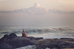 Woman sitting seaside Stock Photo